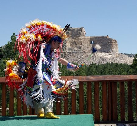 A Native American dancer performs in front of Crazy Horse Memorial in western South Dakota. (Photo courtesy of Crazy Horse Memorial)